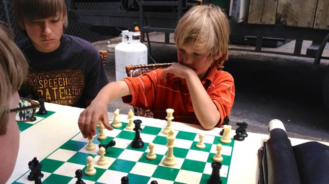 My son Josiah at a small chess tournament at a book fair.