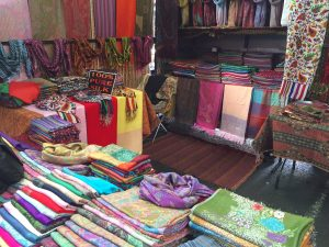 This is Asaad's store at the Melbourne Markets. Genuine Syrian scarves and table clothes.