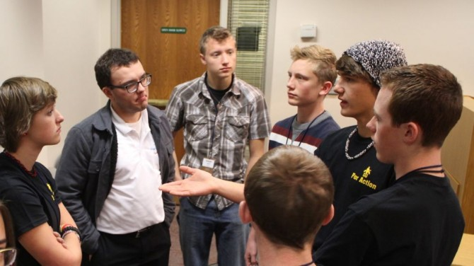 Josh (2nd from left) connecting with others at the For Action Conference.