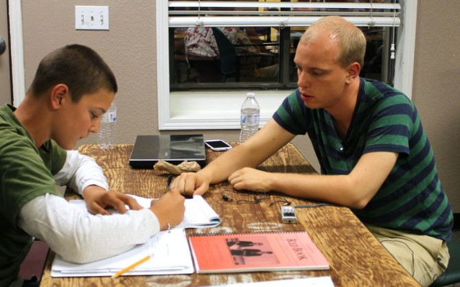 Lincoln-Douglas 2012 Titlist Matthew Erickson (right) coaches a student at Training Minds LD Camp in Colorado.